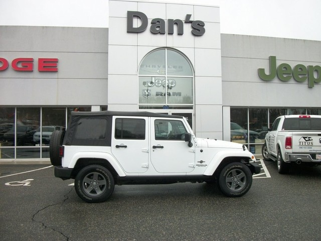 pre-owned 2015 jeep wrangler unlimited freedom edition sport utility